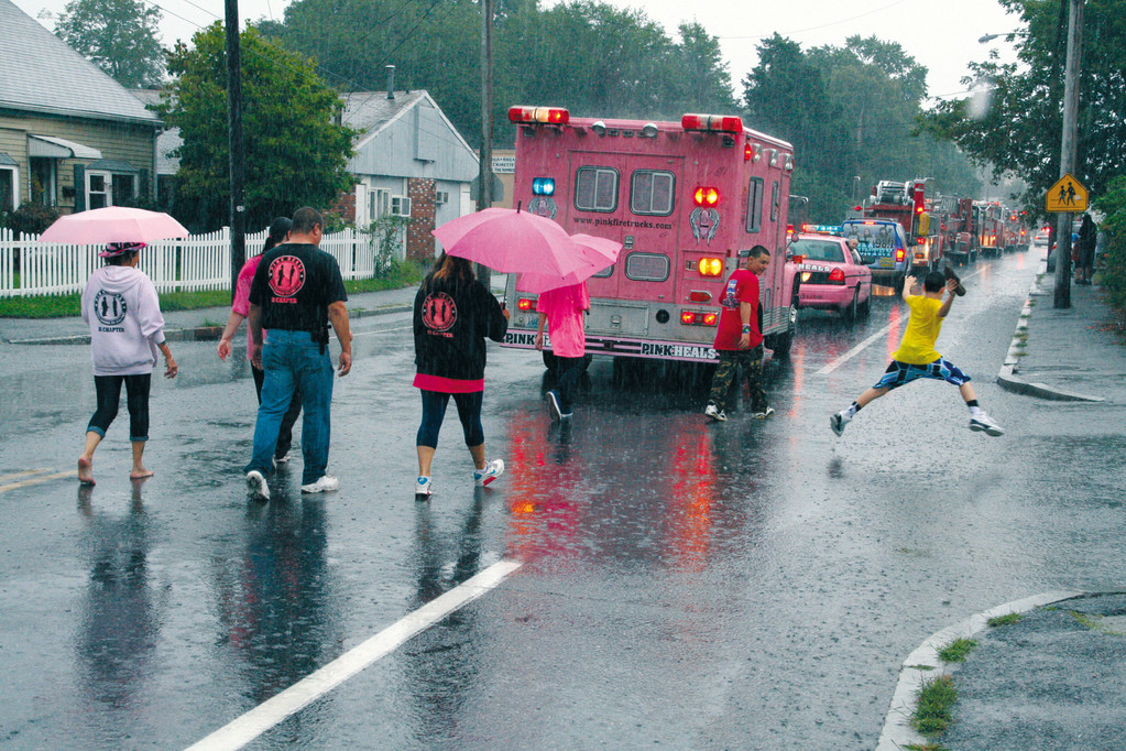 TRUCKING ON: Despite the 2 p.m. downpour, the Pink Heals Oakland Beach Parade went on as planned with about 15 trucks making their way down Oakland Beach Avenue along with a small number of brave marchers.