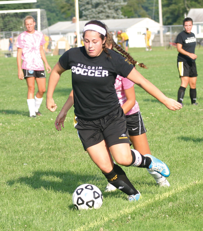RETURNERS: Haley McCusker moves the ball through the midfield.