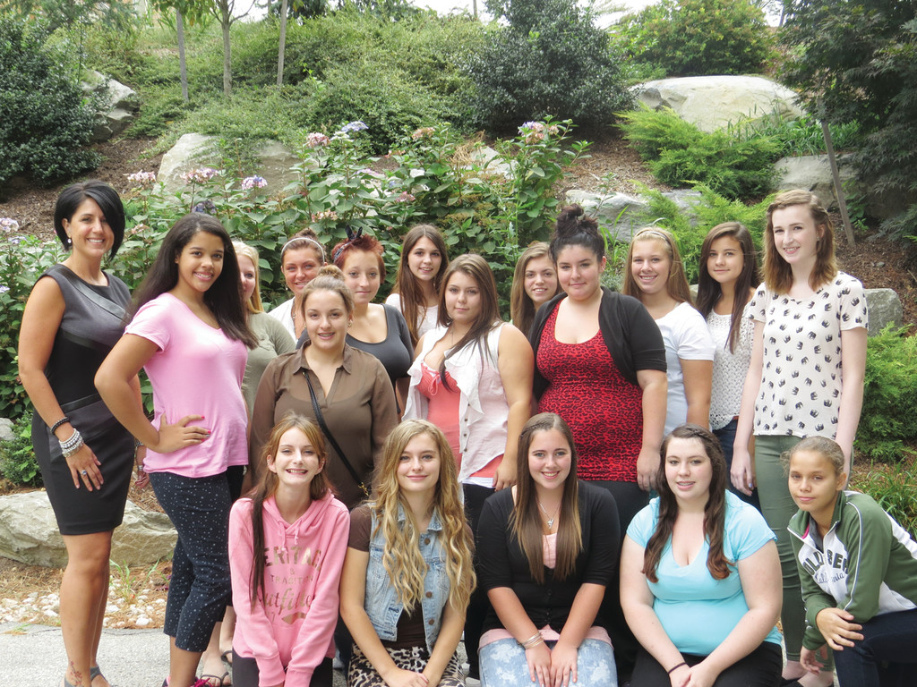 FIRST CLASS: The first 18 girls to enroll in the Warwick Area Career and Technical Center�s Cosmetology program are excited about the new program and eager to get onto a salon floor with the help of their teacher, Christina Pompei (pictured far left).
