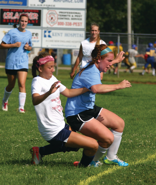 Elizabeth Gemmell collides with an opposing player.