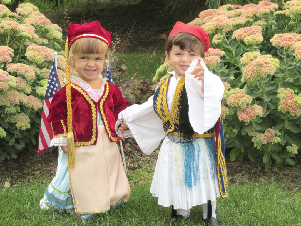 DRESSED AND READY: Sophia Nicholas, 4, and Kosta Rougas, 1, are adorned in their Evzone, the complete outfit that older members of the Odyssey Dance Troupe will wear this weekend during the 28th annual Cranston Greek Festival.