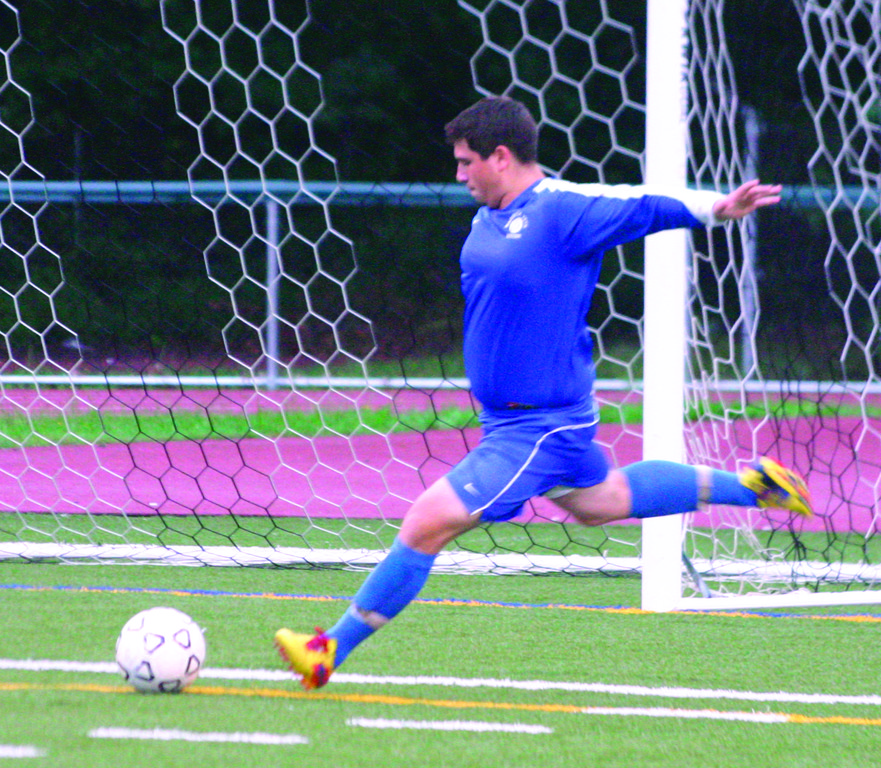 FULL FORCE: Vets sweeper Brad Robert takes a goal kick during tournament action on Tuesday
