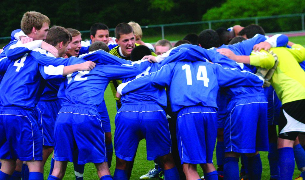 PUMPED UP: Vets goalie Mike Riccitelli gets his team fired up before Tuesday's Warwick Vets Fall Soccer Tournament.