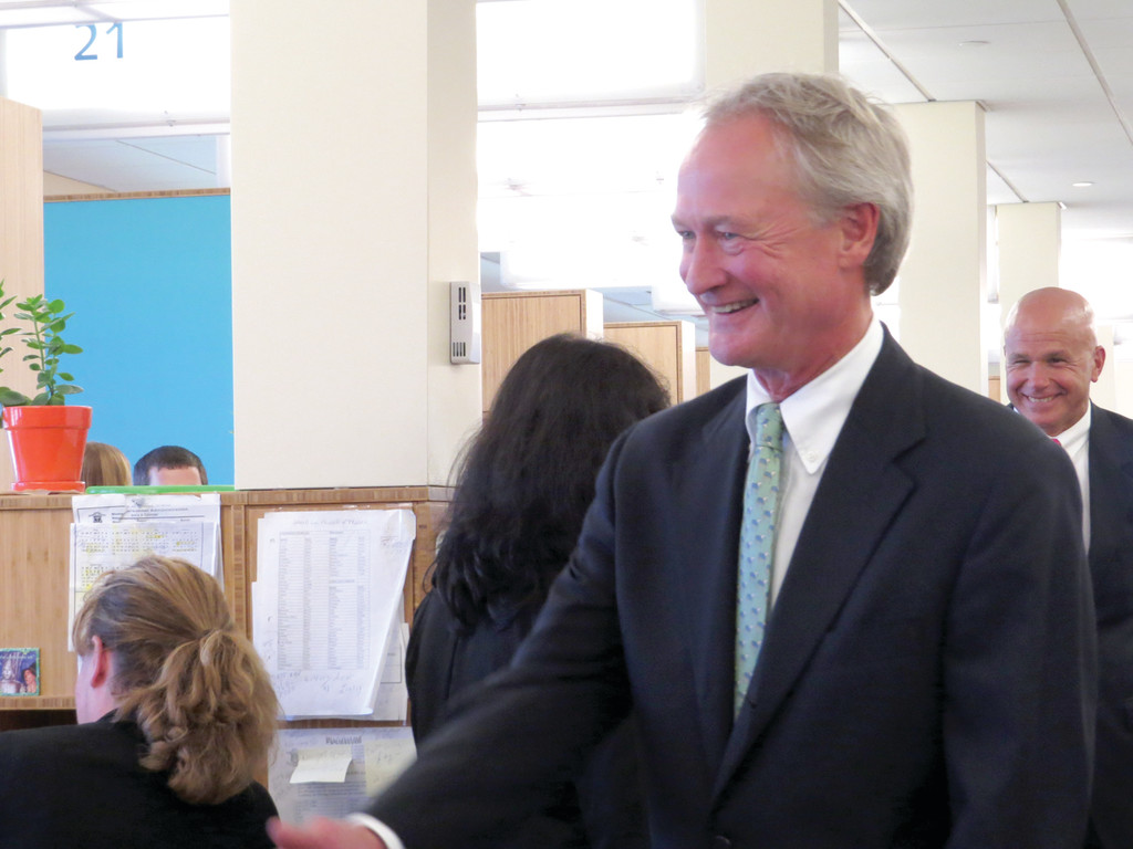 MEETING THE PUBLIC: Following his announcement he would not be seeking re-election, Chafee took a walk through the Cranston DMV building, greeting workers and citizens. Chafee said he chose to make his announcement at the DMV because lowering wait times is one of the many achievements from his term he is proud of.