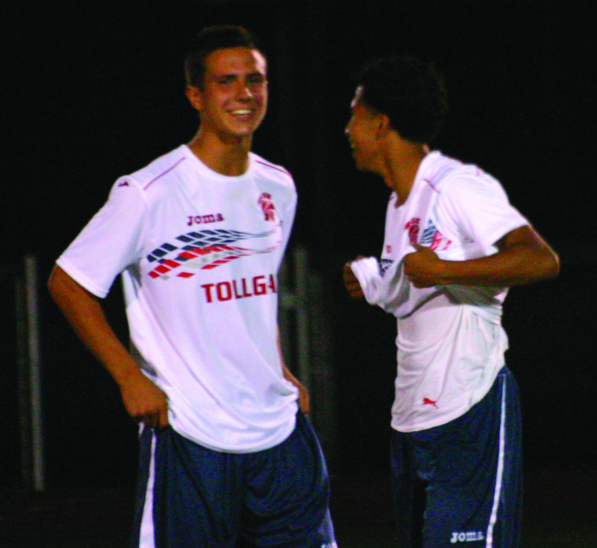 ALL SMILES: Toll Gate forwards Josh Sandin (left) and Jose Beltran share a laugh before the start of the championship game in Tuesday's Warwick Vets Fall Soccer Tournament.