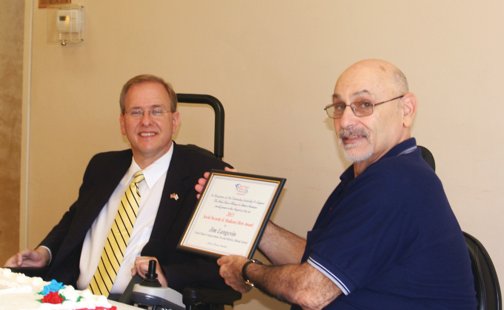 A HERO TO SENIORS: Congressman James Langevin received the 2013 Social Security Medicare and Medicaid Hero Award from the Rhode Island Alliance for Retired Americans. President John Pernorio praised Langevin for his work on behalf of Rhode Island seniors.