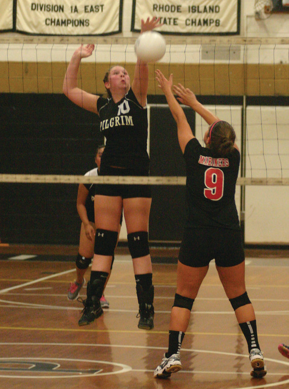 Megan St. Jacques stretches to make a block. Both Ferreira and St. Jacques are juniors playing big roles for the Pats.