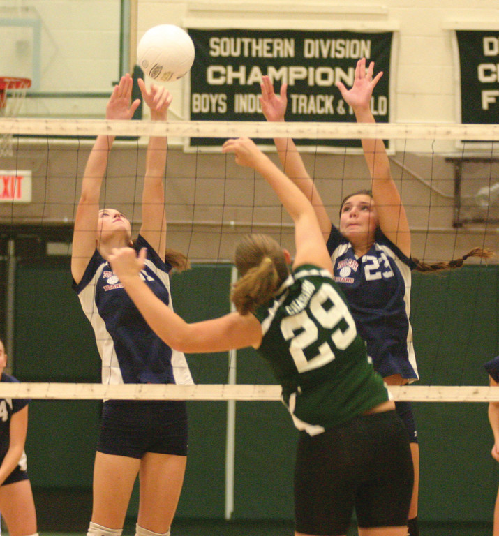 REACHING: Toll Gate's Courtney Marsh (left) and Jamie Hopgood rise for a block in Thursday's season opener against Chariho. The Titans were swept but are hoping for some positives as they get set for another year in the state's highest division.