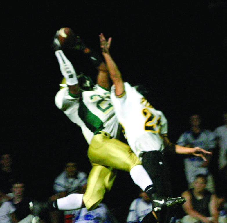Hendricken�s Lee Moses makes a leaping grab in the end zone.