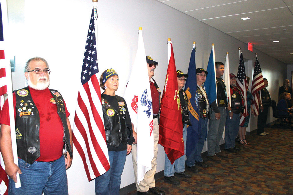 AT ATTENTION: A group of at least 15 Patriot Guard Riders line the wall outside the lounge.