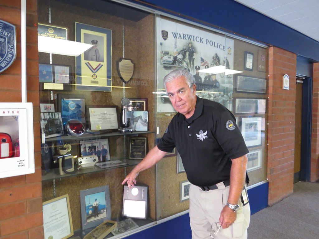 BRINGING HISTORY HOME: Currently, this display case in the lobby of the Warwick Police Station features memorabilia from Providence Police. Inspector Mathiesen hopes to return those items to Providence and fill the case with Warwick Police artifacts and photos.