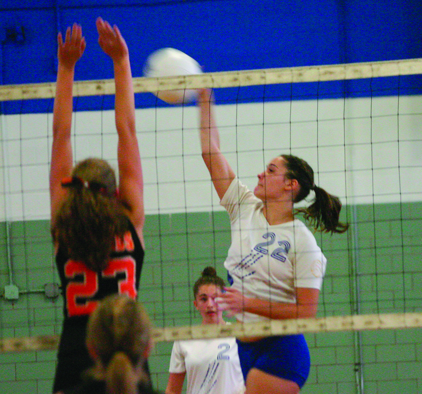RISING HIGH: Freshman Shannon McCarthy goes up for a kill during Vets' match with West Warwick on Thursday