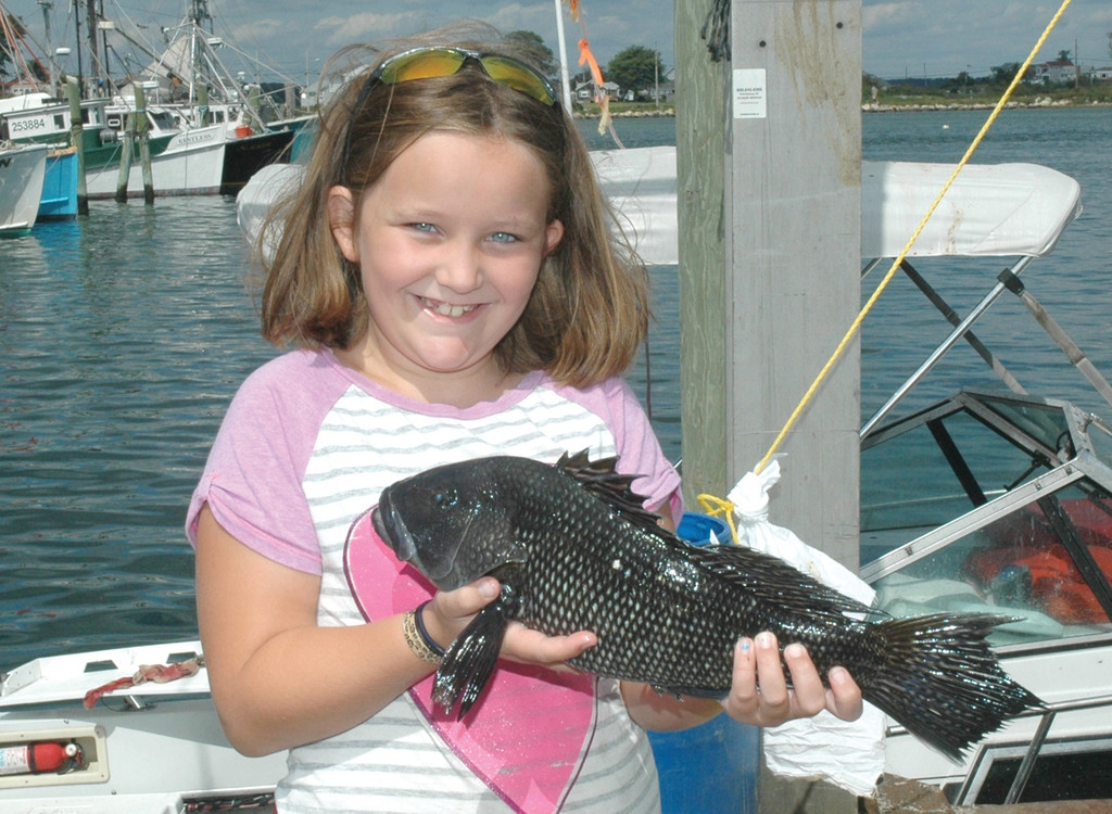 BLACK SEA BASS: Jillian LeBlanc of Warwick with the black sea bass that earned her 3rd place in the Junior Boat Division at the Galilee Fishing for Hope Tournament.