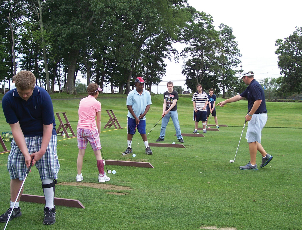 INSTRUCTIONS FROM A PRO: Sargent students receive instructions on the proper golf swing at Valley Country Club.