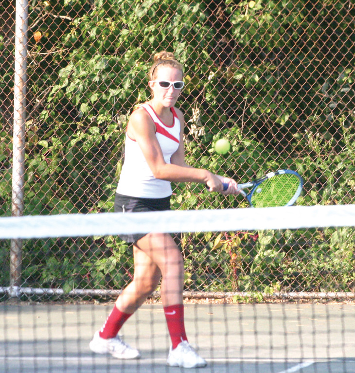Caroline Waggoner lines up a backhand at No. 1 singles.