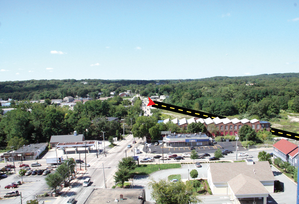 VILLAGE BYPASS: An extension of Veterans Memorial Drive to the intersection of Centerville and Toll Gate Roads, as drawn on a picture of Apponaug as seen from the City Hall tower, would divert through-traffic from the village.