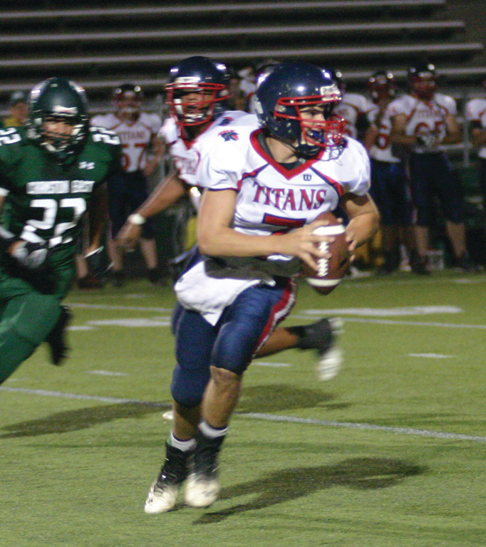 RUNNING LANES: Toll Gate quarterback Joe Brosnahan rolls out and looks for a receiver.