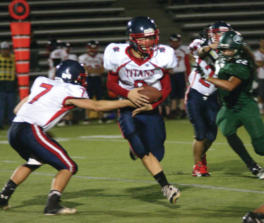 OFF AND RUNNING: Aaron Travers takes a handoff from Joe Brosnahan in Friday's game.