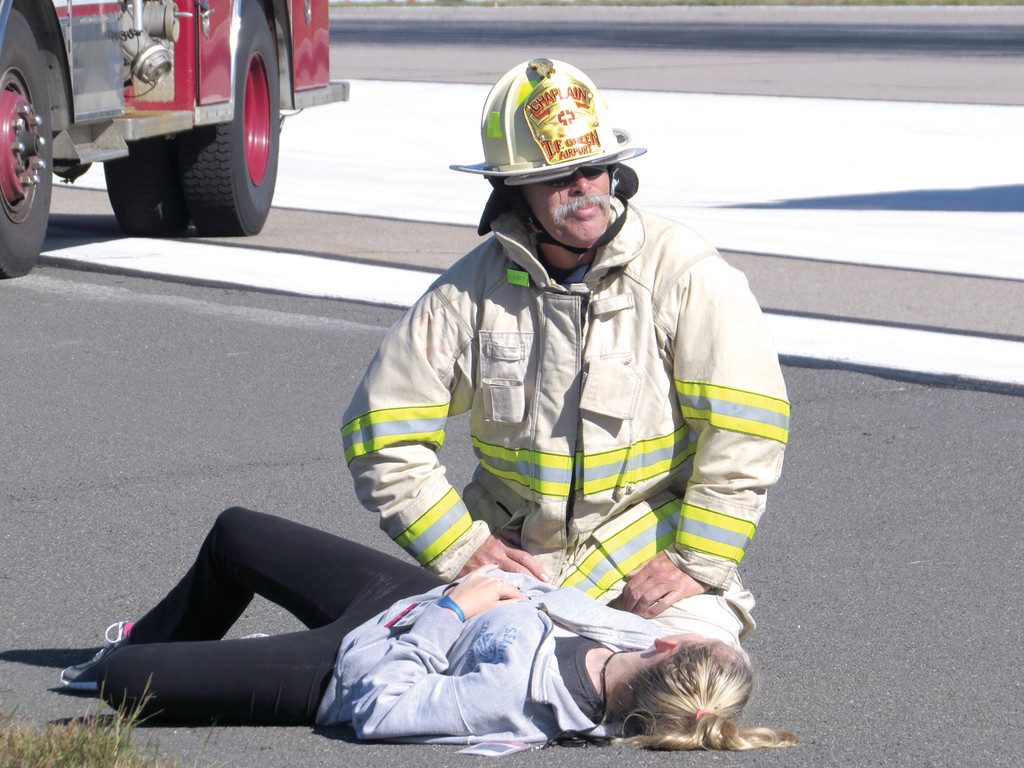 PLAYING THEIR ROLE: Over 250 volunteers came out to play victims of a plane crash on the northeastern portion of the airfield at T.F. Green. Volunteers took their roles very seriously, many crying out in pain as firefighters worked to keep them calm.