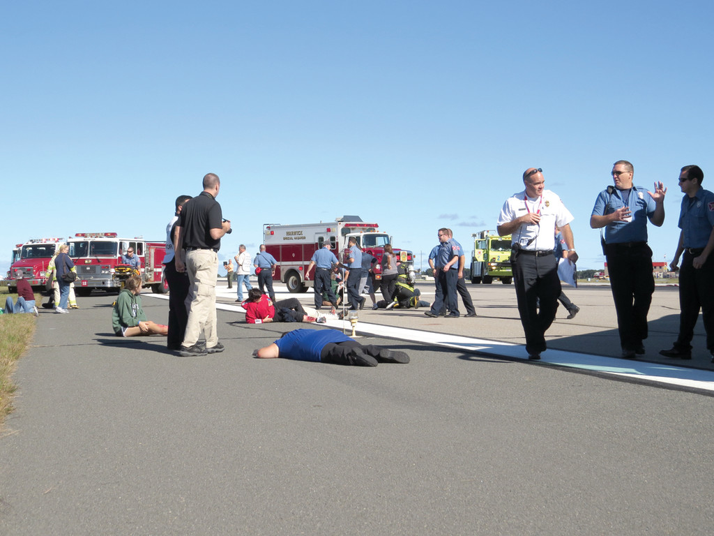 QUITE THE SCENE: Rescue personnel from T.F. Green�s own police and fire as well as Warwick Police and Fire were on hand during Saturday�s mock disaster drill, practicing their response and communication methods in the event of a plane crash on the runways. Mutual aid units from surrounding cities, including Cranston, Providence, East Greenwich, West Warwick and more, were also present. Each department was given a wait time mirroring how long it would take them to get to the scene after receiving the call, ranging from two minutes to 22 minutes.