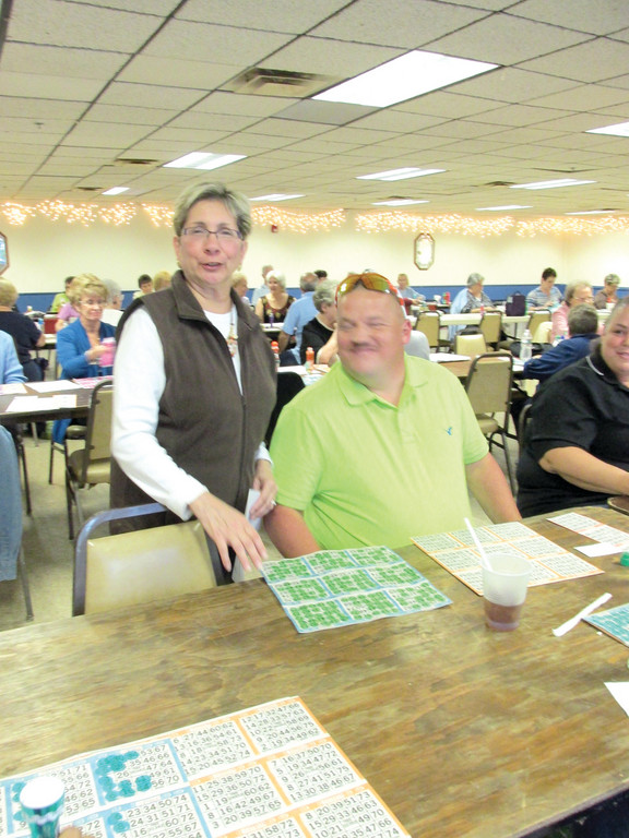 When Bingo came back to the Tri-City Elks Lodge two weeks ago after a 20-year absence, the first game winner, Frank Levesque, smiles as Past Exalted Ruler Donna Warner verifies his numbers.