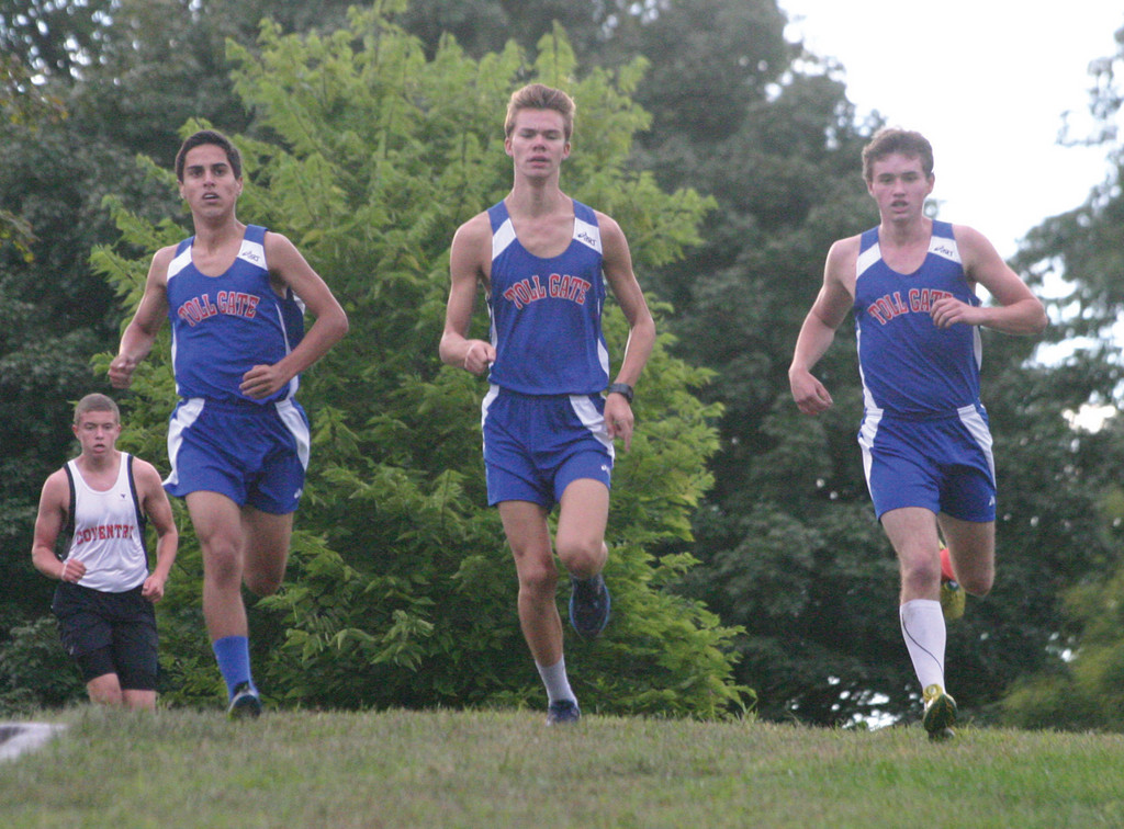 Pat Rocchio, Brock Massa and Alex Pires run together.