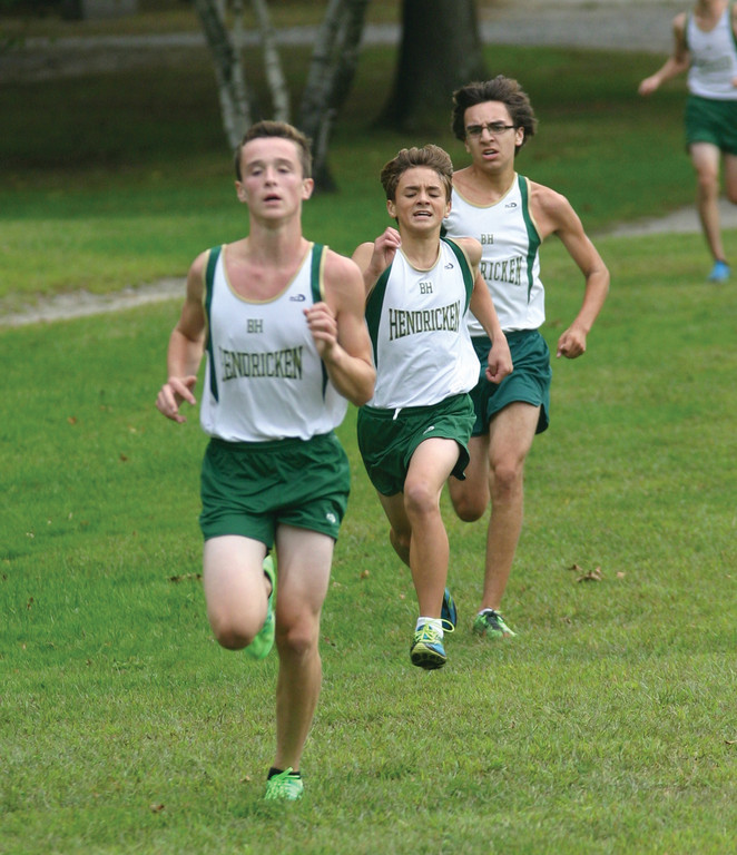 HAWK DEPTH: Caleb George, Matt Wilks and Chris Ferreira head for the finish line in Monday's dual meet at Goddard Park.