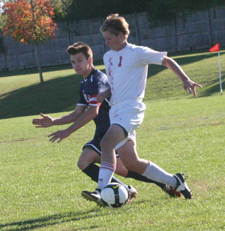 Trent Colford keeps a defender on his hip while dribbling up the field.