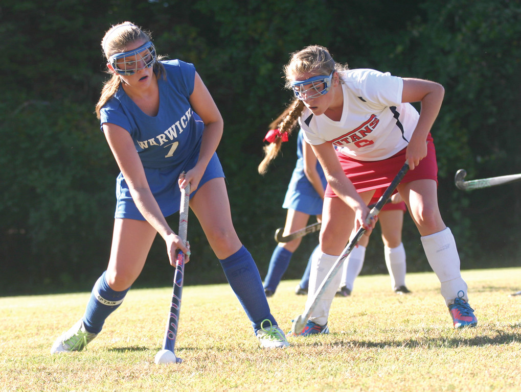 ONE-ON-ONE: Above, Savannah Hersey makes a pass in front of Toll Gate