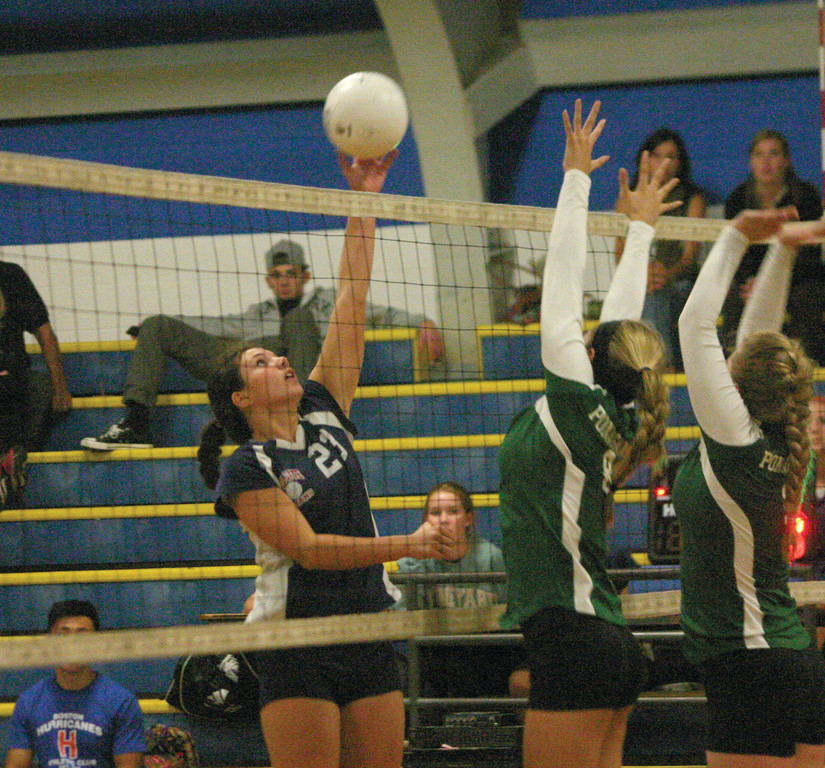 UP AND OVER: Jamie Hopgood tips the ball over the net during Toll Gate