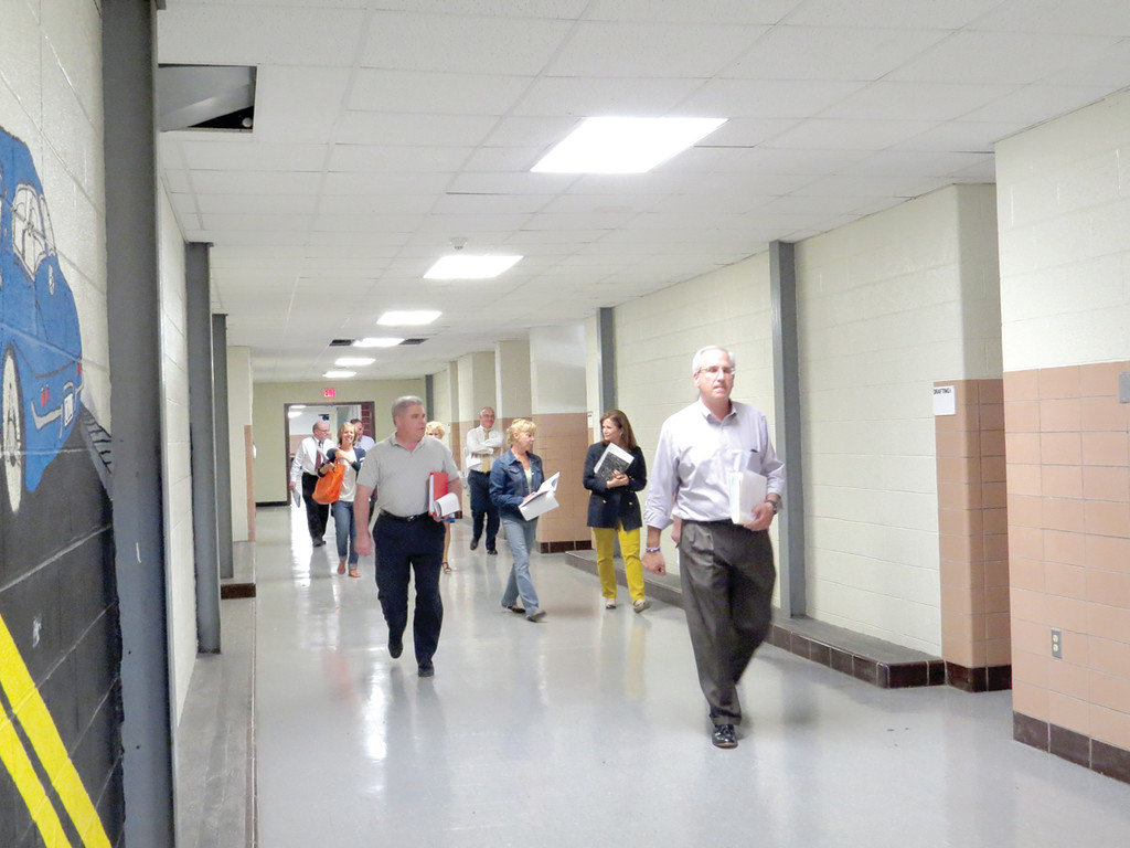 ROAMING THE HALLS: On Tuesday afternoon, members of the Long Term Facilities Planning Committee took the time to tour Warwick Veterans Memorial High School as they prepare to make a recommendation for consolidation at the secondary level. Tours of Pilgrim High School and Toll Gate High School are also planned.
