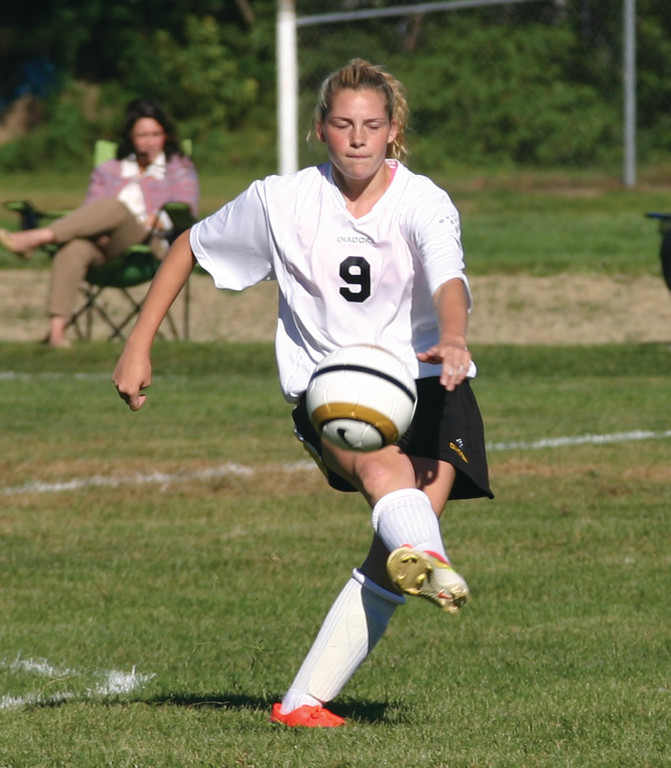 Kendra Levesque plays the ball ahead.