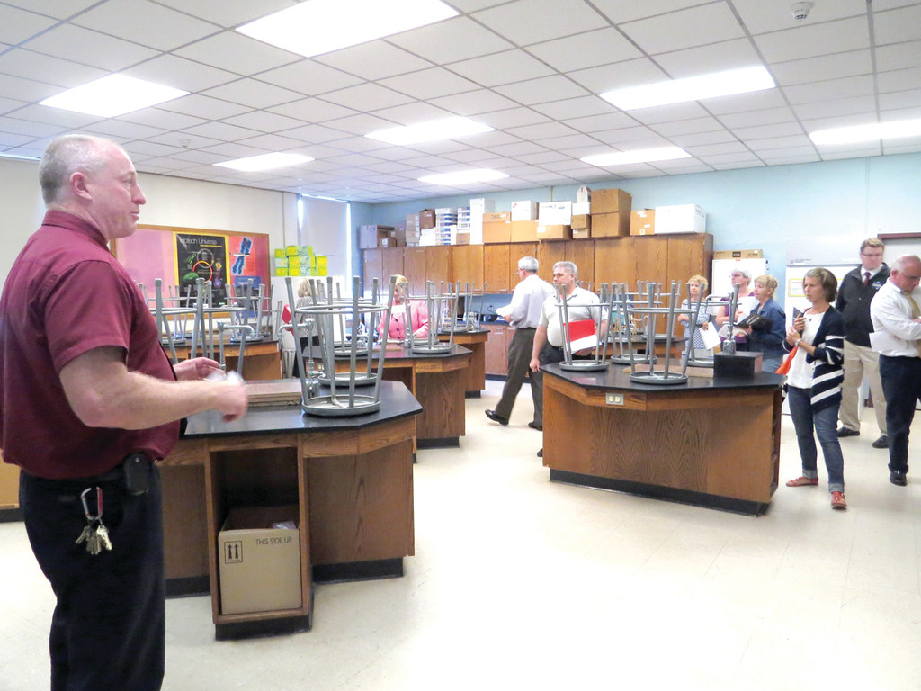 SIGHTSEEING: Principal Gerry Habershaw took the time to point out many of the unique features of Vets High School to members of the Long Term Facilities Planning Committee, including a bio-tech lab with donated equipment used by the school