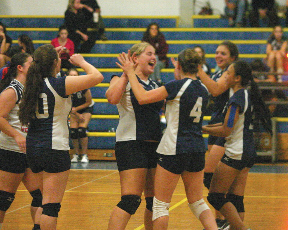 SOMETHING TO CELEBRATE: Danielle Anderson, Lexi Hassell (4) and their Toll Gate teammates celebrate Monday