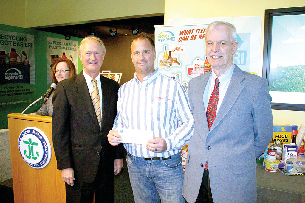 HEFTY CHECK: Governor Lincoln Chafee and Rhode Island Resource Recovery Corporation executive director smile as Warwick