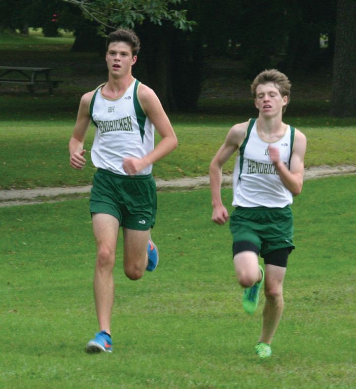 PACK LEADER: Hendricken senior Colin Tierney, (left) pictured earlier this season, won the Manchester Invitational over the weekend and led the Hawks to a second-place finish.