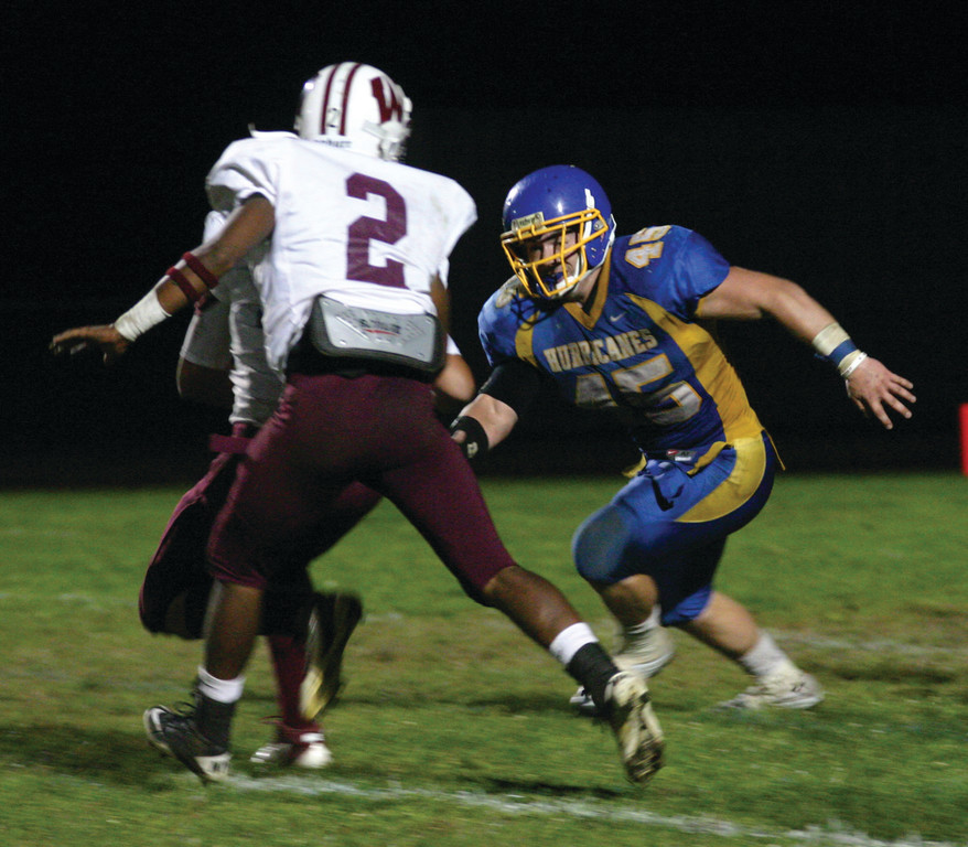 ANTICIPATION: David MacDonald lines up a hit on a Woonsocket ballcarrier this past Friday.