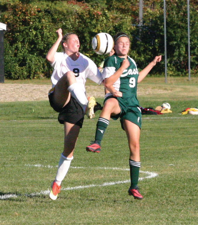 Kendra Levesque battles for a header.