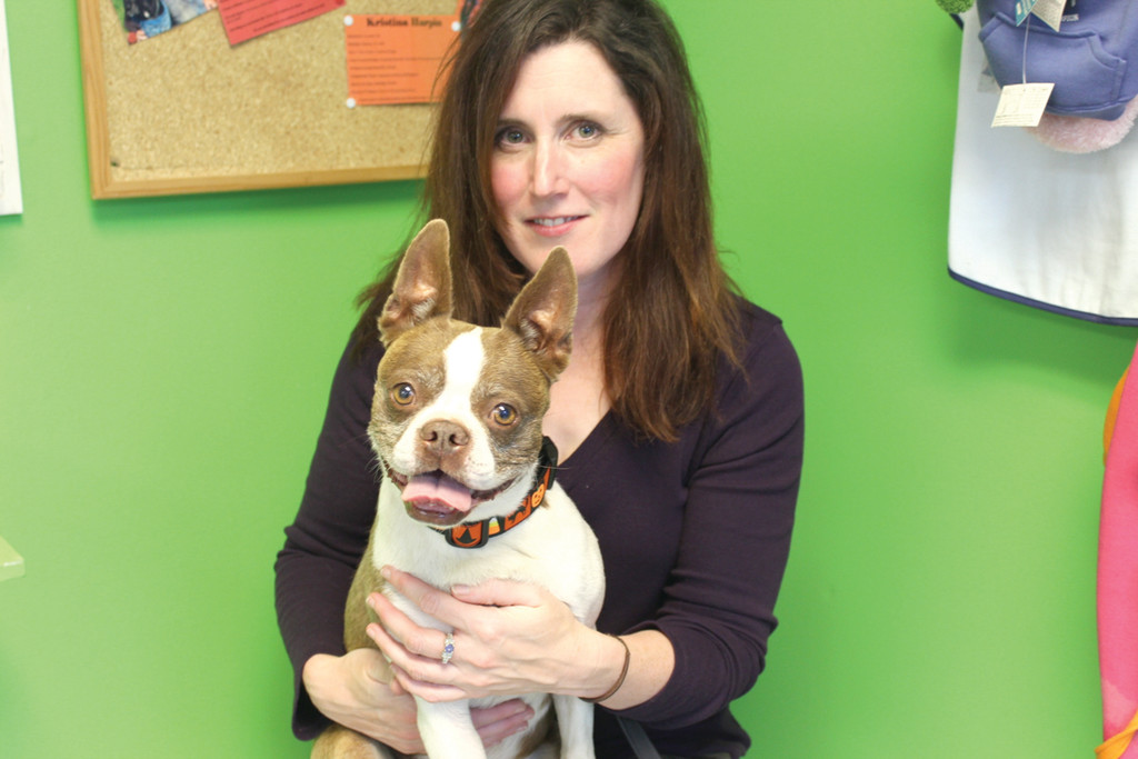 DOG LOVER: McDonough smiles with her dog, JoJo, a Boston Terrier.