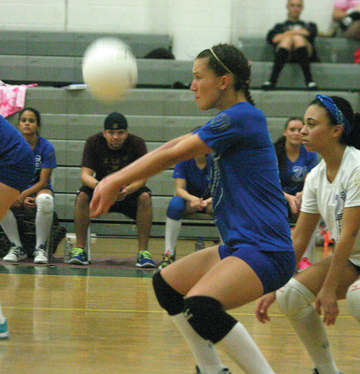 BUMP: Emily Walason makes a pass for Vets in Tuesday's match against Cranston East.