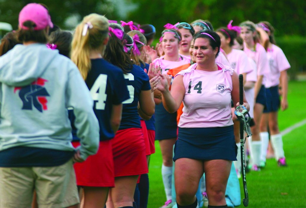 GOOD SPORTS: Players from Toll Gate and Rocky Hill go through the handshake line after their game and pink out.