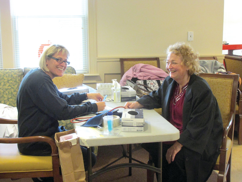 ASSIST WITH DRIVE: Rhode Island Blood Center phlebotomists Sue Lynne and Joan Risotti were part of last week