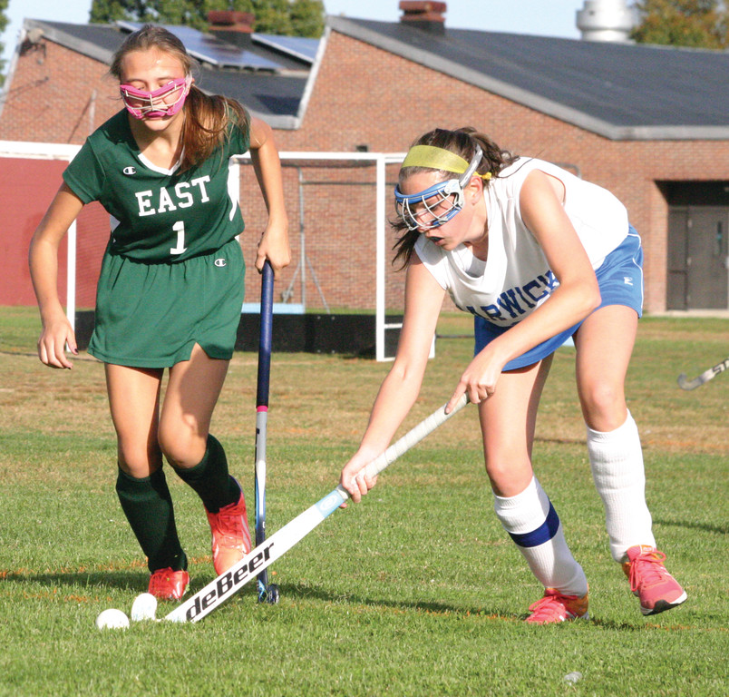 REACHING: Allison Stopyra gets possession against East
