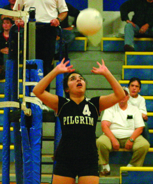 Nancy Alvarez puts up a set for the Pats.