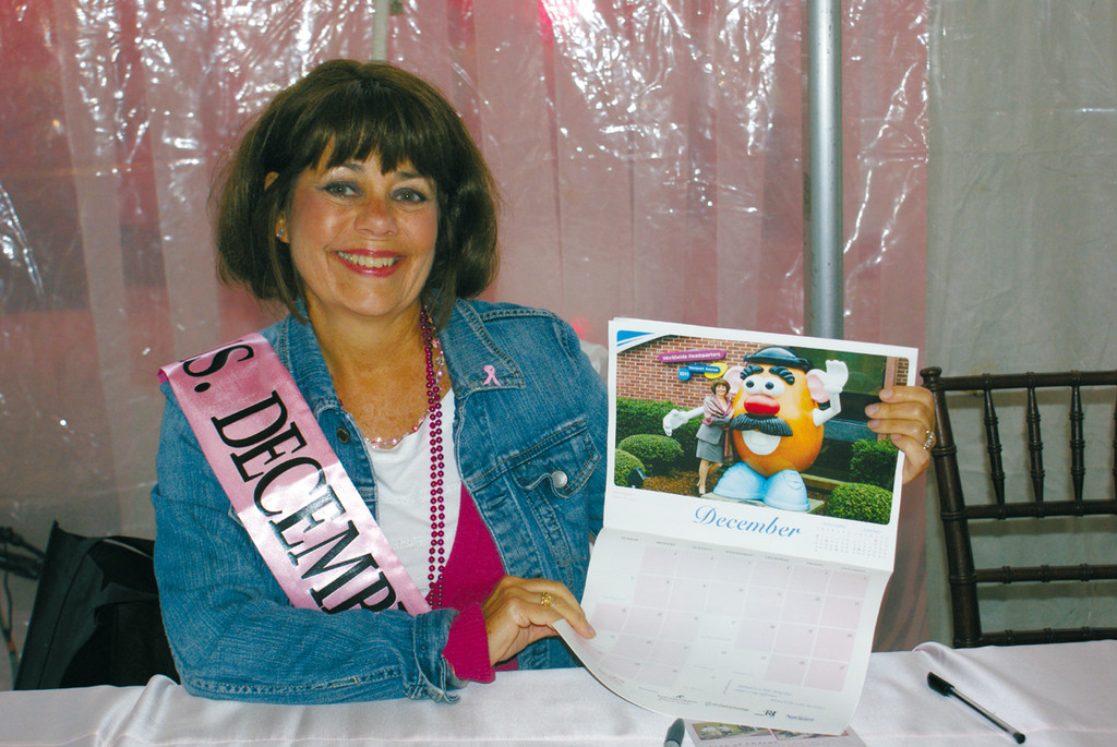 CALENDAR GIRL: On the opening night of the Gloria Gemma Flames of Hope Celebration weekend was the 2014 Calendar Unveiling ceremonies featuring breast cancer survivors from the area. Pictured is Ms. Diane Stamp of Cranston who is Ms. December.