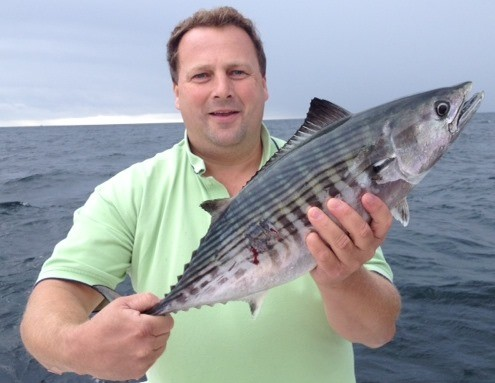 Bonito bite:  Eric Lundgren of Cumberland with the bonito he caught one mile southeast of the Charlestown Breachway. Both bonito and false albacore have been caught all along the southern coastal shore.
