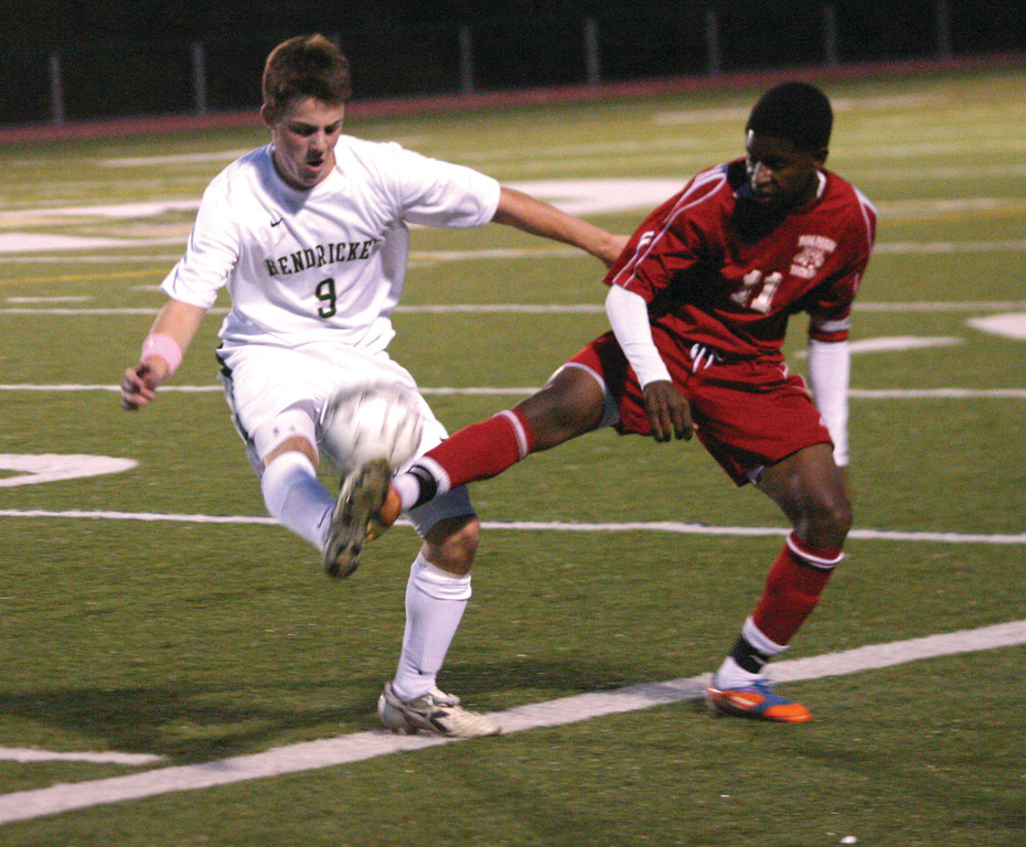 TWO FEET: Hendricken's Reed Worthington battles Tolman's Ibrahima Male for possession during Tuesday's game. The Hawks won 2-0 to move into fifth place in the Division I standings.