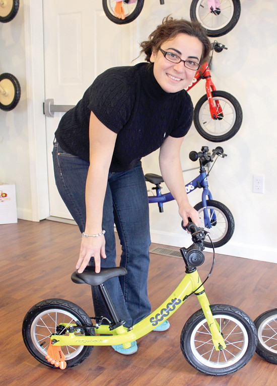 BALANCE BIKES: Ebru shows an example of a balance bike.