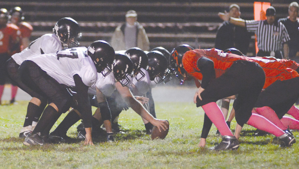 LINED UP: The Pilgrim offensive line gets set for the snap in Friday