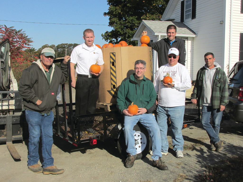 PUMPKIN CREW: This was the scene early last Saturday morning where Slocum Realty purchased 2,775 pounds and a total of 900 pumpkins that owners, agents and friends delivered to homes in Warwick. Taking part in the Rite of Fall was, from left: Jim Morris, Jon Tetrault, Bob DeGregorio, Phil Slocum, Nick Slocum and Paul Sullivan.